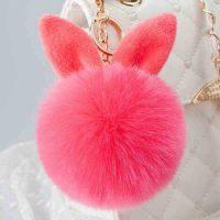 Móc khóa bông xù tai thỏ lông đỏ dưa hấu cực mịn