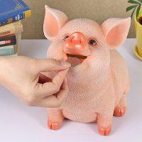 Ống heo giữ tiền tiết kiệm lợn ngậm xu đáng yêu